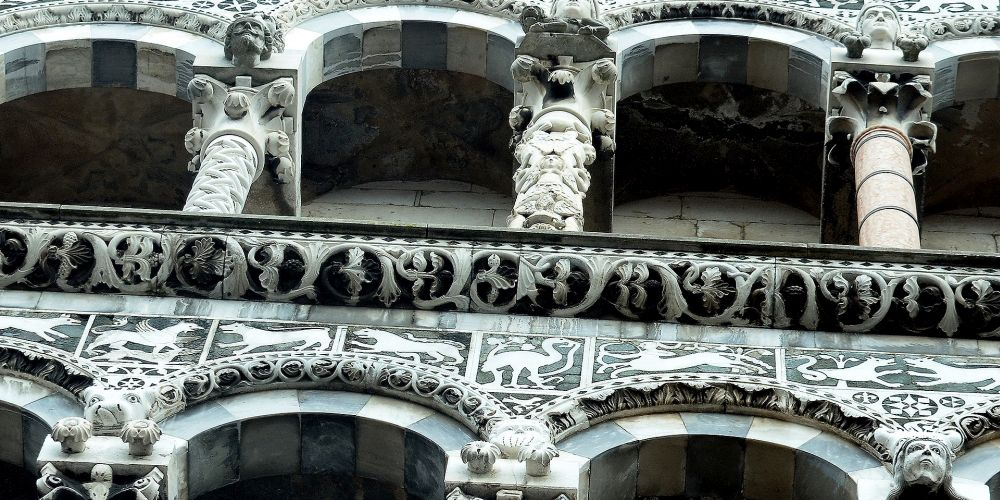 details of the facade of church saint michael in Lucca