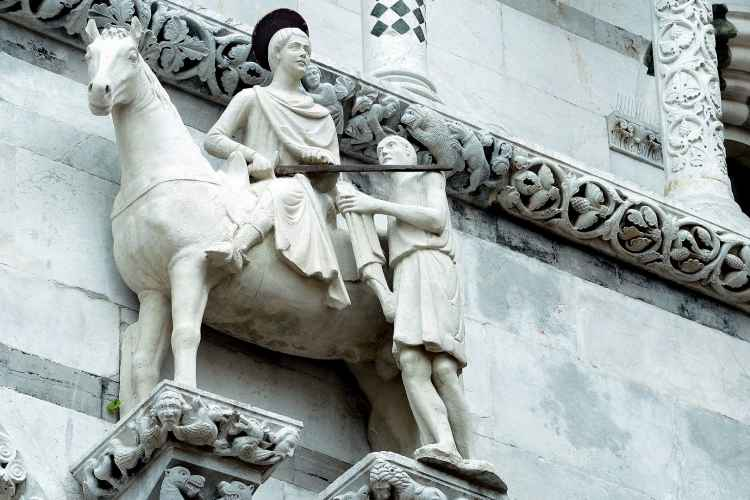 statue of San Martino on the facade of the cathedral of Lucca